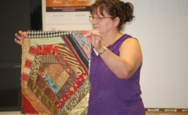 Meg shows her crazy quilt block from a class she's in